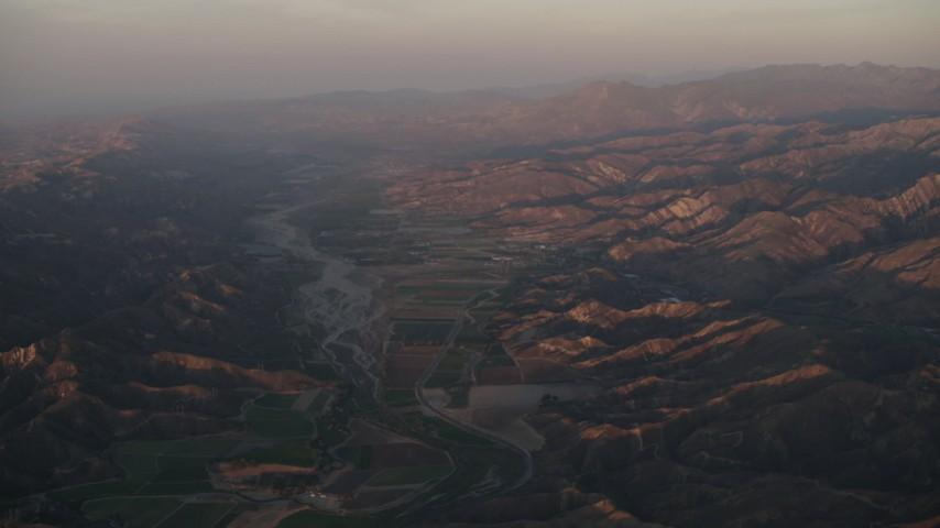 4K stock footage aerial video Farm fields by the Santa Clara River at sunrise, Piru, California Aerial Stock Footage | AX70_007