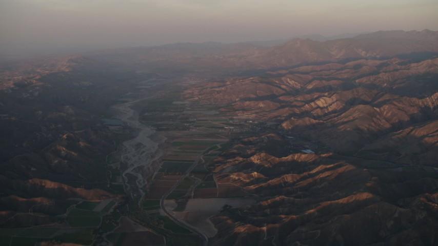 4K stock footage aerial video Farmland by the Santa Clara River at sunrise, Piru, California Aerial Stock Footage | AX70_008