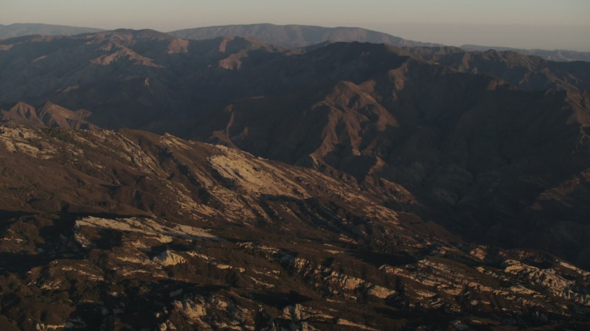 4K stock footage aerial video Rugged slopes and mountain ridge at sunrise in Los Padres National Forest, California Aerial Stock Footage | AX70_013