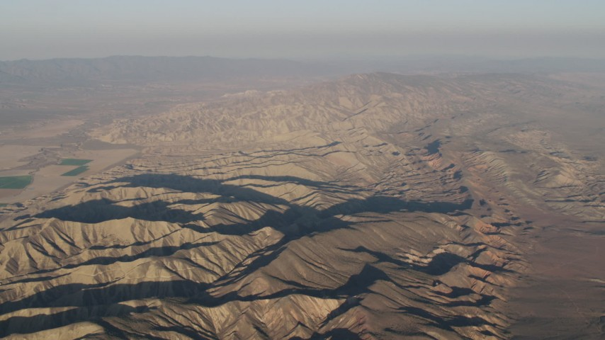 4K stock footage aerial video Flyby mountain ridges at sunrise, Cuyama, California Aerial Stock Footage | AX70_031