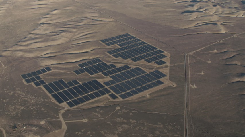 4K stock footage aerial video Tilt to a bird's eye view of large solar arrays at the Topaz Solar Farm in the Carrizo Plain, California Aerial Stock Footage | AX70_055