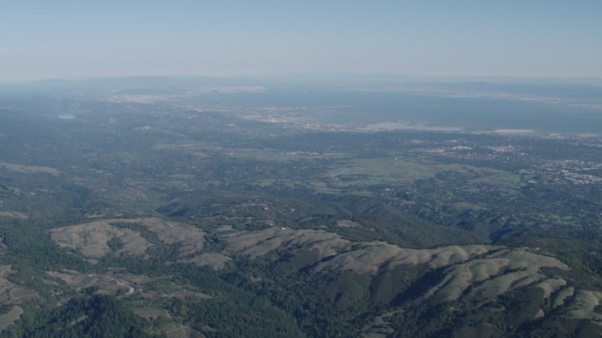 4K stock footage aerial video of A view of San Francisco Bay seen from the Santa Cruz Mountains, California Aerial Stock Footage | AX70_089