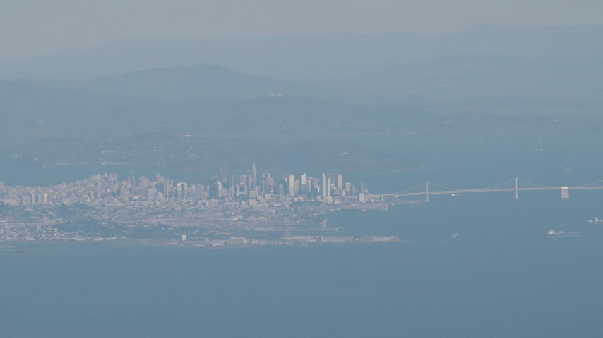 4K stock footage aerial video Downtown San Francisco and the Bay Bridge as a commercial jet flies over city, California Aerial Stock Footage | AX70_092