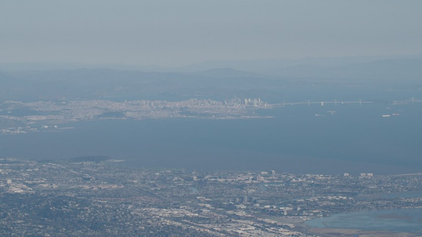 4K stock footage aerial video San Francisco, the Bay Bridge, and San Francisco Bay seen from San Mateo, California Aerial Stock Footage | AX70_093