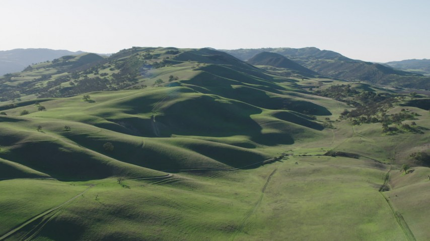 4K stock footage aerial video Green hills and trees in Paicines, California Aerial Stock Footage   AX70_140