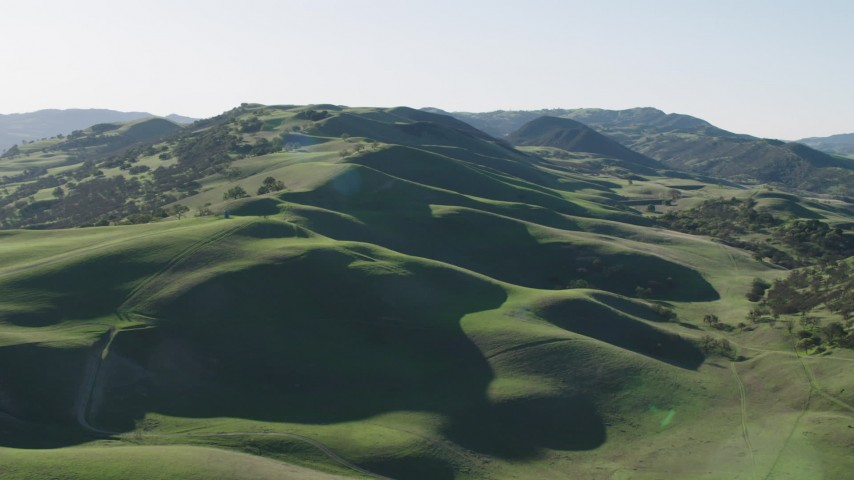 4K stock footage aerial video A view of green hills with trees in Paicines, California Aerial Stock Footage   AX70_141