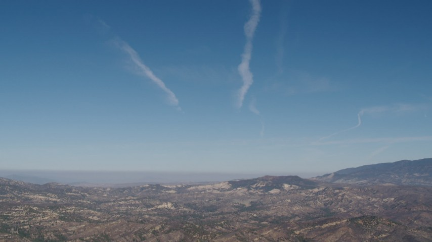 4K stock footage aerial video Blue skies and sparse clouds above Los Padres National Forest, California Aerial Stock Footage | AX70_199