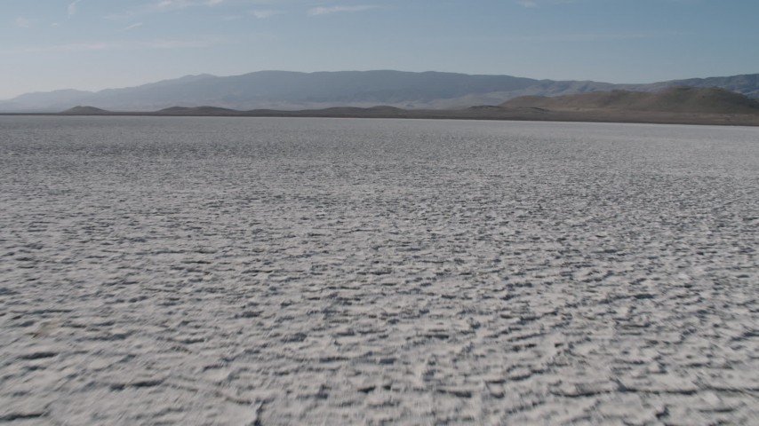 4K stock footage aerial video Fly low over Soda Lake in California, to approach desert mountains Aerial Stock Footage | AX70_217