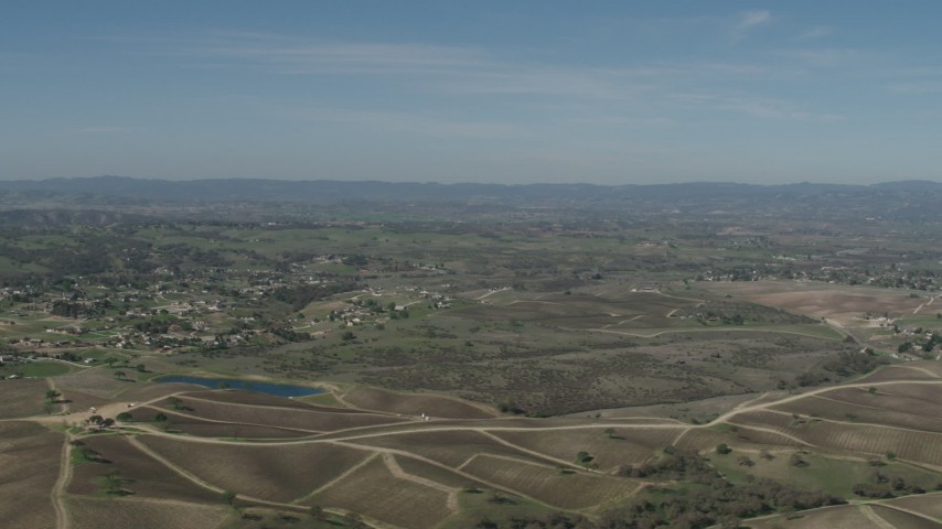 4K Aerial Video Flyby rural homes, vineyards, and a pond in Paso Robles, California Aerial Stock Footage | AX70_225