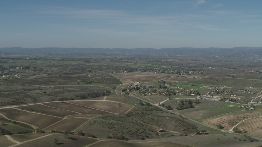 4K stock footage aerial video Flyby rural homes and vineyards in Paso Robles, California Aerial Stock Footage | AX70_226