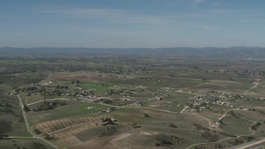 4K Aerial Video Flyby rural homes and vineyards, reveal State Route 46 in Paso Robles, California Aerial Stock Footage | AX70_227