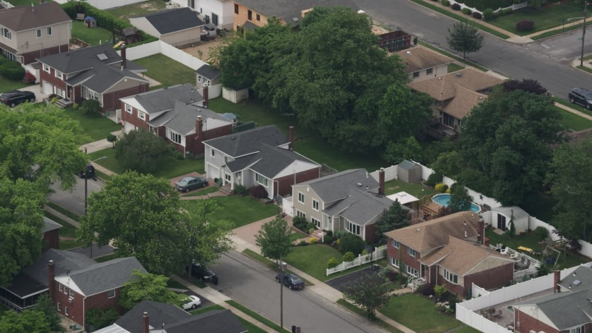 5K stock footage aerial video approaching suburban homes in Massapequa Park, Long Island, New York Aerial Stock Footage | AX71_002