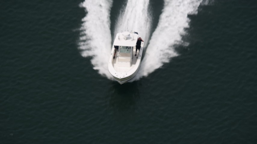 5K stock footage aerial video of fishing boat cruising across Jones Bay by Wantagh, Long Island, New York Aerial Stock Footage | AX71_016