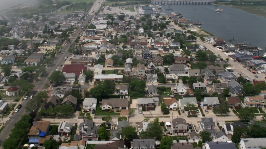 5K stock footage aerial video flying over a seaside neighborhood in Point Lookout, Long Island, New York Aerial Stock Footage | AX71_020