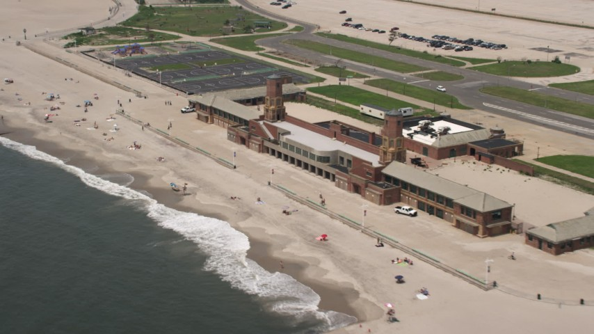 5K stock footage aerial video of sunbathers on the beach at Jacob Riis Park, Queens, New York Aerial Stock Footage   AX71_038