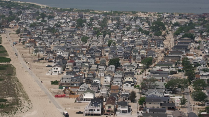 5K stock footage aerial video flying past beachfront homes in Breezy Point, Queens, New York Aerial Stock Footage | AX71_041