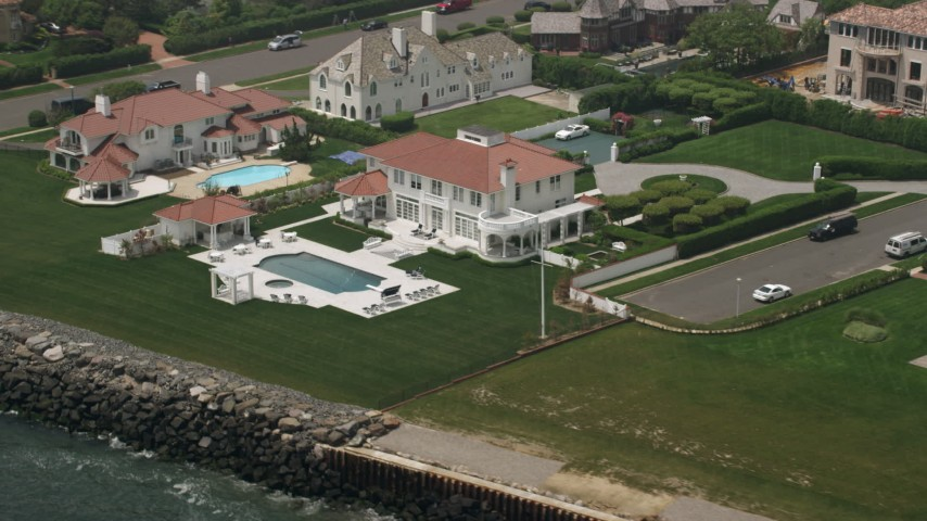 5K stock footage aerial video flying by an upscale oceanfront home in Long Branch, Jersey Shore, New Jersey Aerial Stock Footage | AX71_061