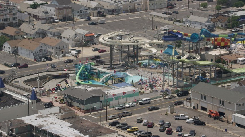 5K stock footage aerial video of Breakwater Beach Waterpark, Seaside Heights, Jersey Shore, New Jersey Aerial Stock Footage | AX71_095