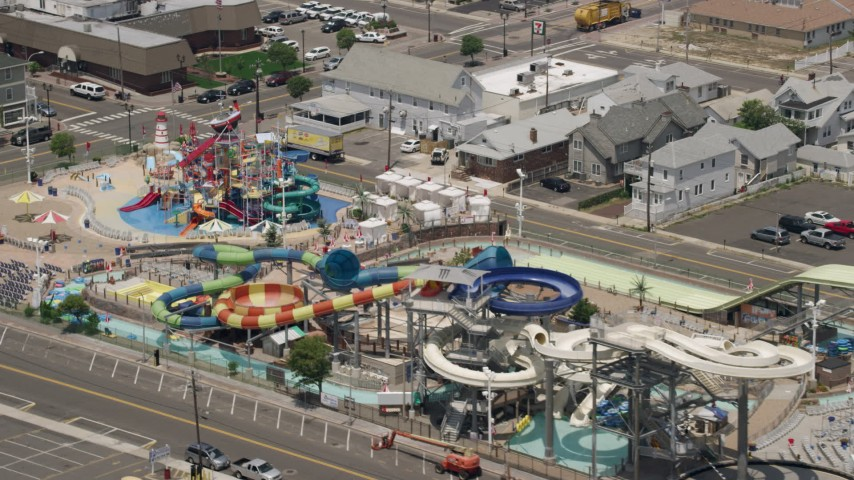 5K stock footage aerial video flying by the Breakwater Beach Waterpark, Seaside Heights, Jersey Shore, New Jersey Aerial Stock Footage | AX71_097