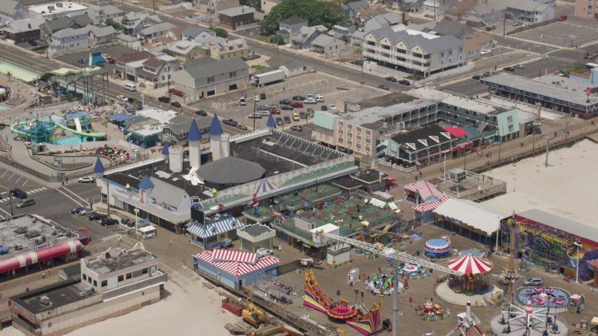5K stock footage aerial video of Casino Pier, boardwalk, and Breakwater Beach Waterpark, Jersey Shore, New Jersey Aerial Stock Footage | AX71_101