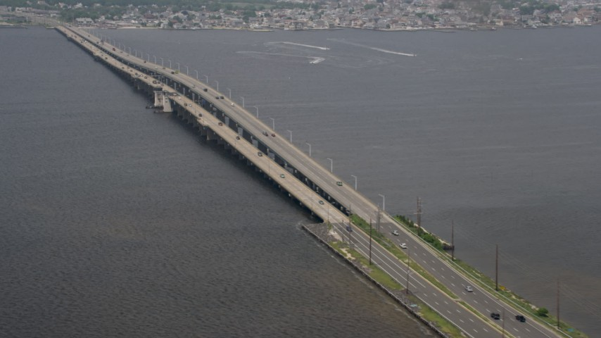 5K stock footage aerial video of Tunney and Mathis Bridges spanning Barnegat Bay, New Jersey Aerial Stock Footage | AX71_103