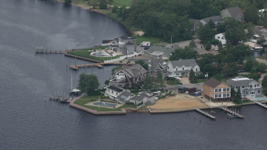 5K stock footage aerial video of upscale riverfront homes with docks, Toms River, New Jersey Aerial Stock Footage | AX71_108