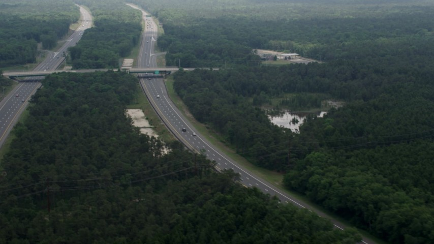 5K aerial video of the Garden State Parkway cutting through Pine Barrens, New Jersey Aerial Stock Footage AX71_126