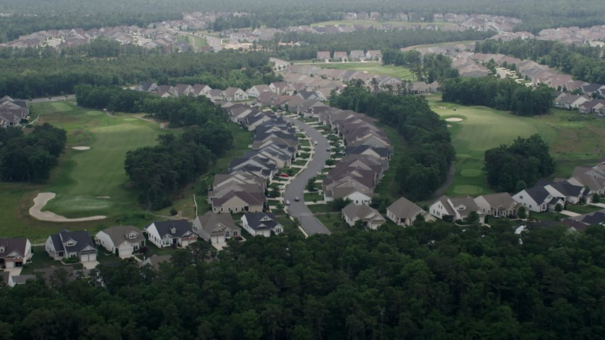 5K stock footage aerial video approaching tract homes on a golf course, Waretown, New Jersey Aerial Stock Footage | AX71_127