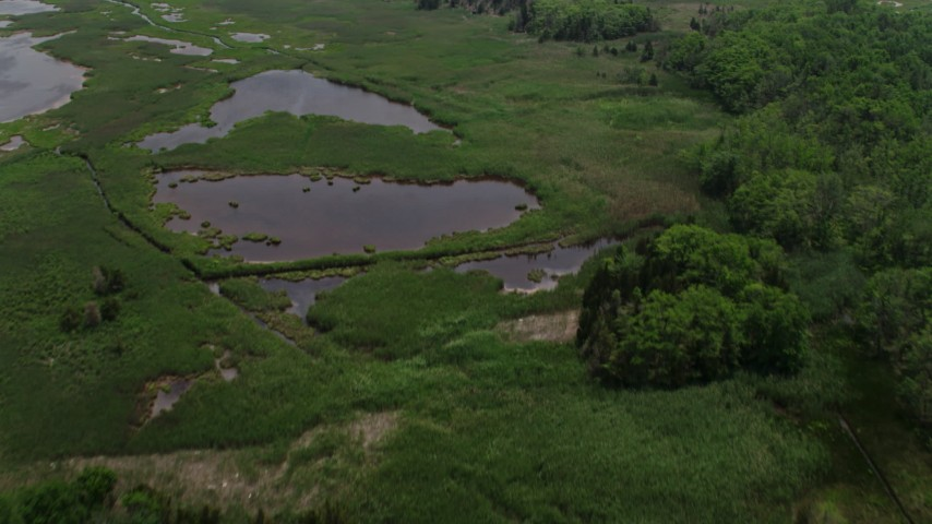 5K stock footage aerial video of marshland and tide ponds in Ocean County, New Jersey Aerial Stock Footage   AX71_133