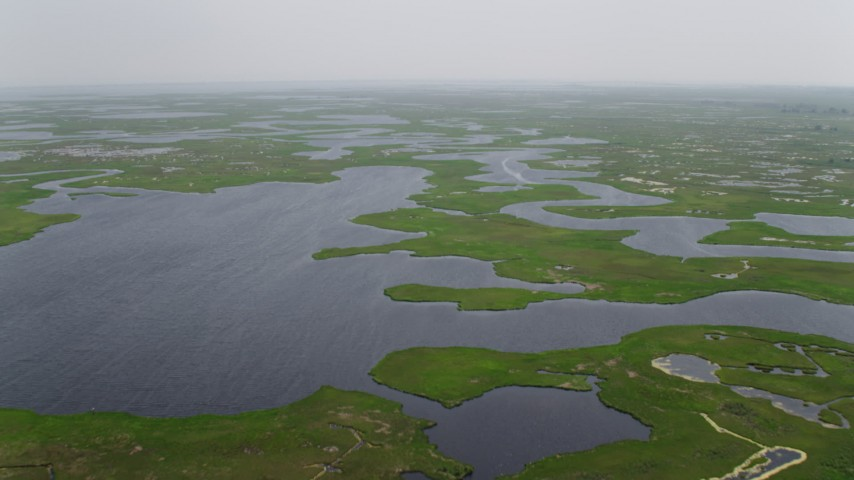 5K stock footage aerial video flying over marshland and tide ponds in Ocean County, New Jersey Aerial Stock Footage   AX71_134