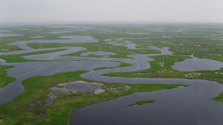 5K stock footage aerial video flying over marshland and tide ponds in Ocean County, New Jersey Aerial Stock Footage   AX71_135