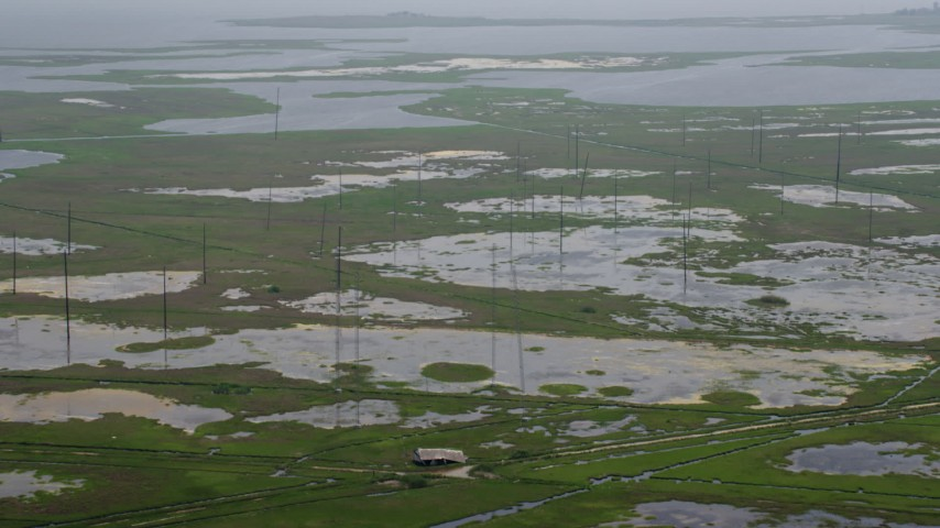 5K stock footage aerial video flying over poles, tide ponds, and marshland in Ocean County, New Jersey Aerial Stock Footage   AX71_137