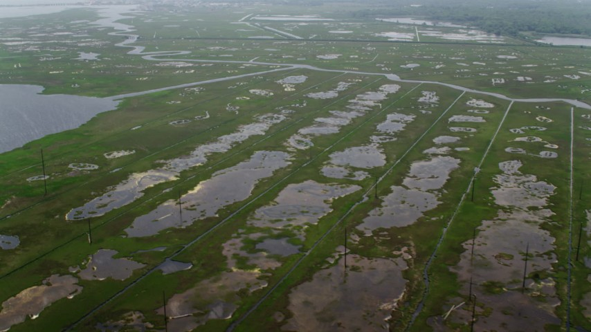 5K stock footage aerial video flying by tide ponds and marshes in Ocean County, New Jersey Aerial Stock Footage   AX71_138