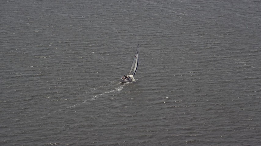 5K stock footage aerial video of a sailboat in Ocean County, New Jersey Aerial Stock Footage   AX71_144