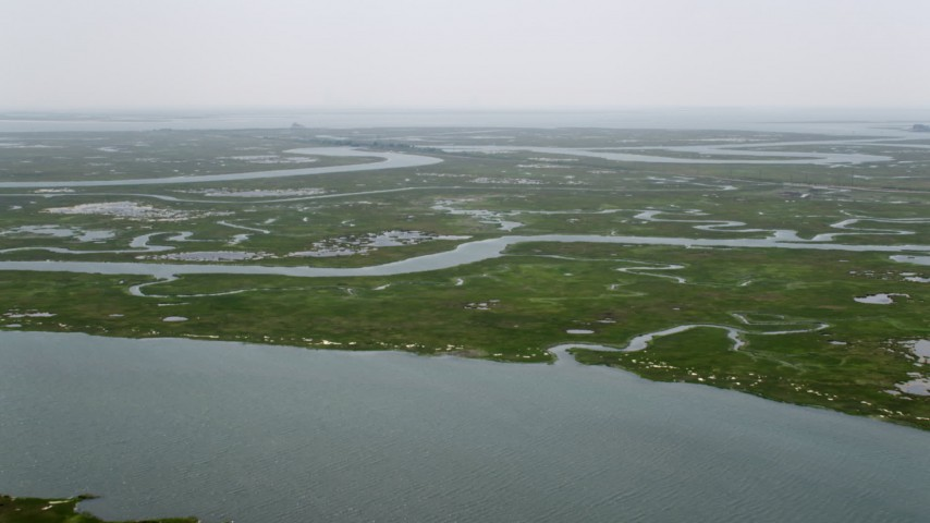 5K stock footage aerial video approaching and flying over wetlands in Ocean County, New Jersey Aerial Stock Footage   AX71_152