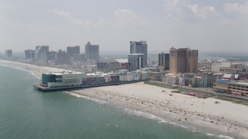 5K stock footage aerial video of Playground Pier by Trump Plaza and Caesars Atlantic City, New Jersey Aerial Stock Footage | AX71_184