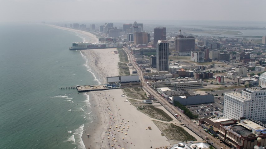 5K aerial video approaching Central Pier, Playground Pier, Atlantic City casino hotels, New Jersey Aerial Stock Footage | AX71_194