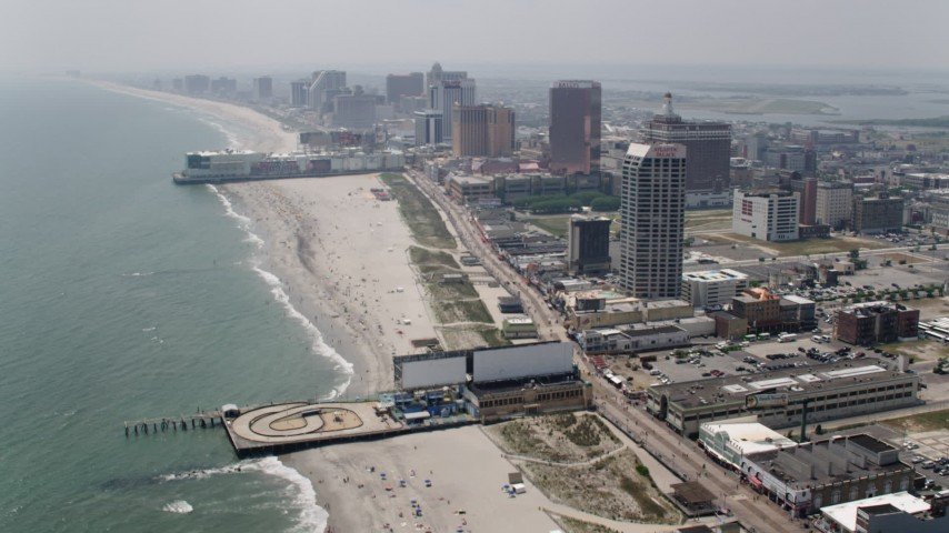 5K stock footage aerial video flying over Central Pier, approach Playground Pier and hotels in Atlantic City, New Jersey Aerial Stock Footage | AX71_195