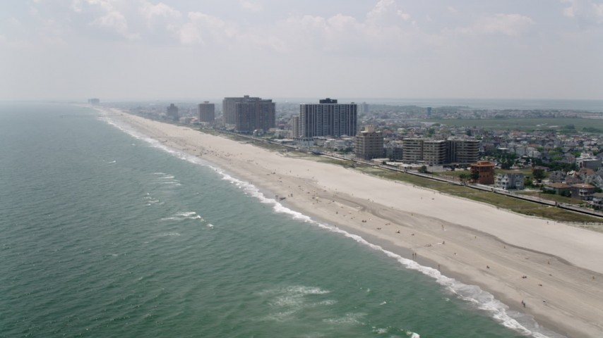5K stock footage aerial video of beachfront condo complexes on the coast of Atlantic City, New Jersey Aerial Stock Footage | AX71_202