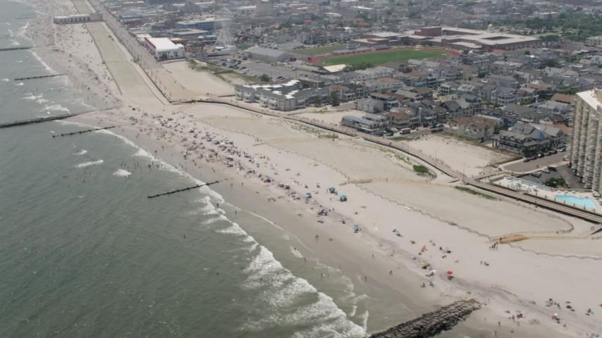 5K aerial video of beach goers enjoying the beach in Ocean City, New Jersey Aerial Stock Footage | AX71_219
