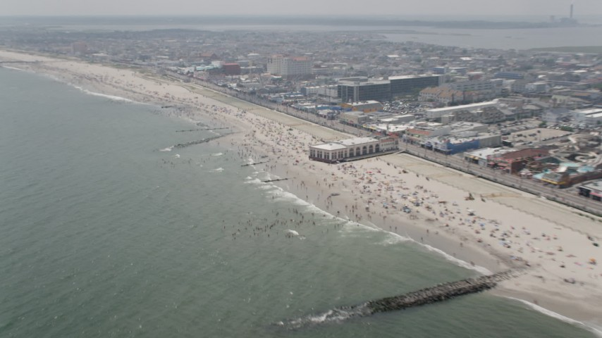 5K aerial video of beach goers on a crowded beach in Ocean City, New Jersey Aerial Stock Footage | AX71_220