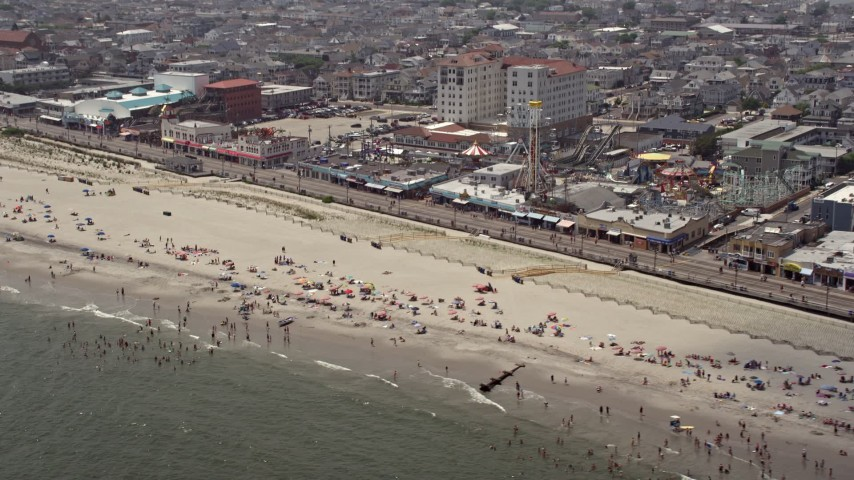 Beach goers near Playland's Castaway Cove, Ocean City, New Jersey Aerial Stock Footage | AX71_221