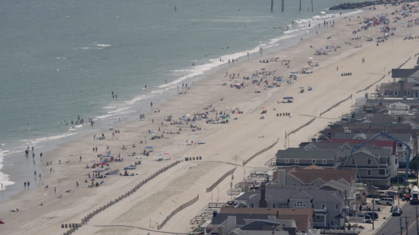 Sunbathers on the beach in Ocean City, New Jersey Aerial Stock Footage | AX71_232