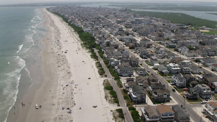 5K stock footage aerial video flying over the beach and beachfront homes in Sea Isle City, New Jersey Aerial Stock Footage | AX71_243
