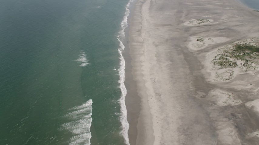 5K stock footage aerial video tilting from an empty beach in Stone Harbor to reveal North Wildwood, New Jersey Aerial Stock Footage | AX71_257