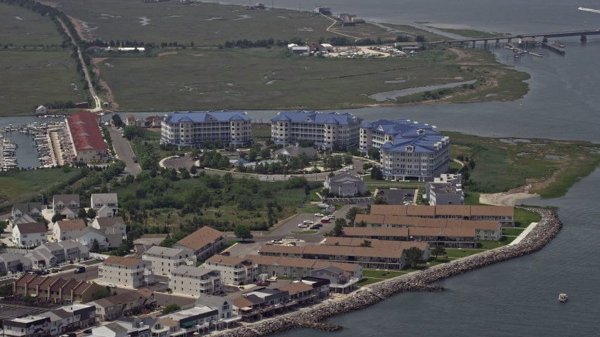 5K aerial video of waterfront apartment complex near Grassy Sound Bridge in North Wildwood, New Jersey Aerial Stock Footage | AX71_258