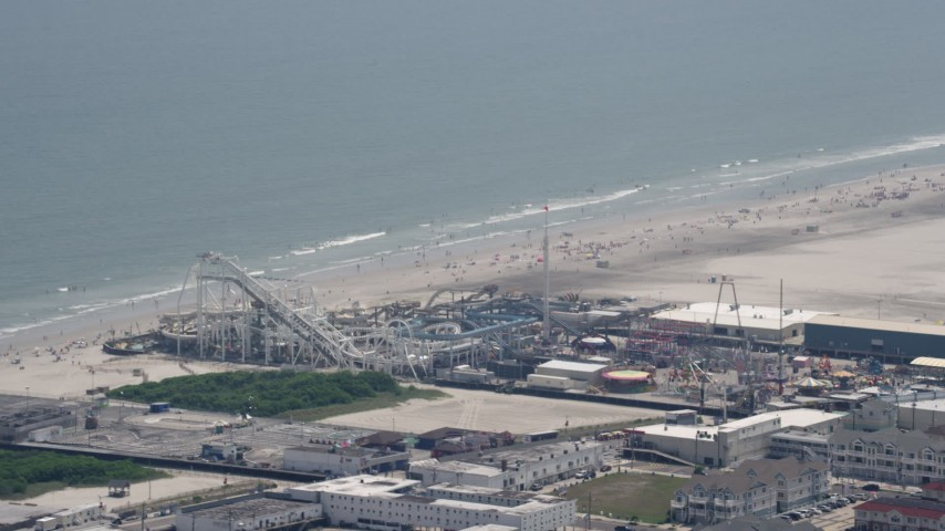5K stock footage aerial video of roller coasters at Surfside Pier in North Wildwood, New Jersey Aerial Stock Footage | AX71_259