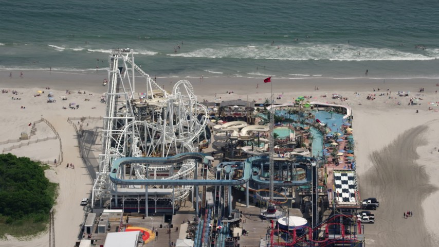 5K stock footage aerial video of Surfside Pier by the beach in North Wildwood, New Jersey Aerial Stock Footage | AX71_260