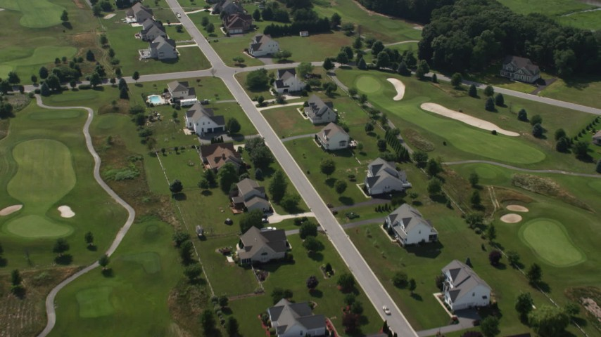 5K aerial video flying by homes by Jonathan's Golf Course in Magnolia, Delaware Aerial Stock Footage | AX72_062