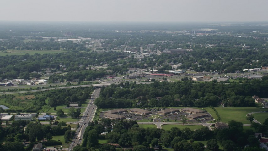 5K stock footage aerial video of office buildings, strip malls, and homes in Dover, Delaware Aerial Stock Footage | AX72_066